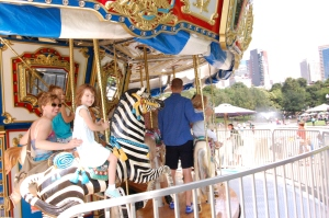 Riding the carousel at Boston Commons