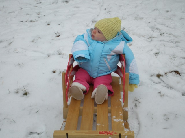 Baby Grace, about 8 months. About two seconds from screaming her desire to be inside and warm.