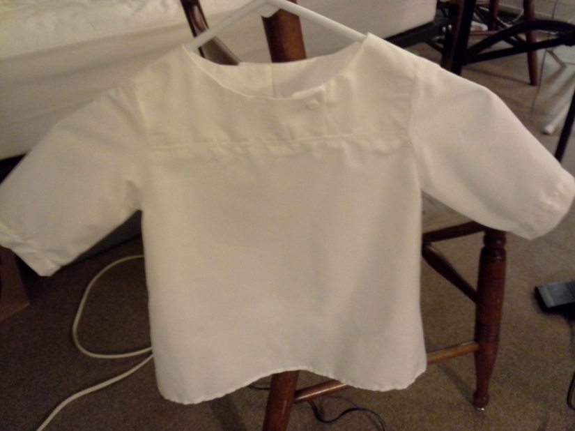 One of my recent sewing projects, a white blouse for Gracie's Easter basket
